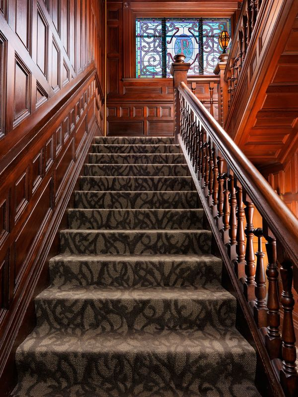 A View of the Stairs Leading Up Our Victorian Era Hotel